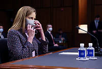 United States. Supreme Court nominee Judge Amy Coney Barrett is seated prior to the start of the third day of Senate Judiciary Committee confirmation hearings for Judge Barrett on Capitol Hill in Washington, U.S., October 14, 2020. <br /> CAP/MPI/RS<br /> ©RS/MPI/Capital Pictures
