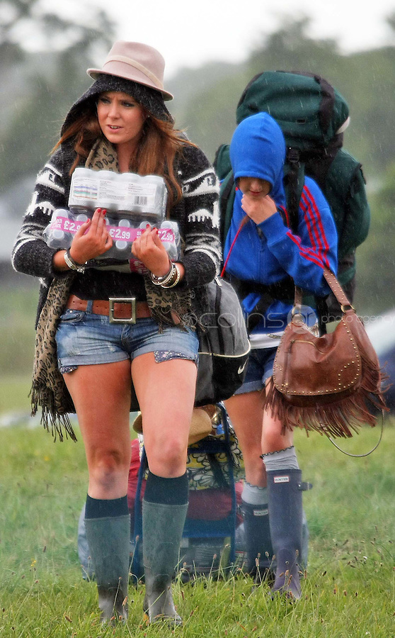 08/07/'10 Emma Kyle and Kim Gallagher from Bangor aarrying supplies pictured arriving at Punchestown, Co. Kildare this evening for the start of the Oxegen Festival 2010...Picture Colin Keegan, Collins, Dublin