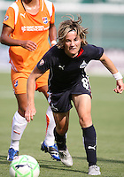 Sonia Bompastor #8 of Washington Freedom pushes the ball forward during a WPS match against Sky Blue FC at RFK Stadium on May 23, 2009 in Washington D.C. Freedom won the match 2-1