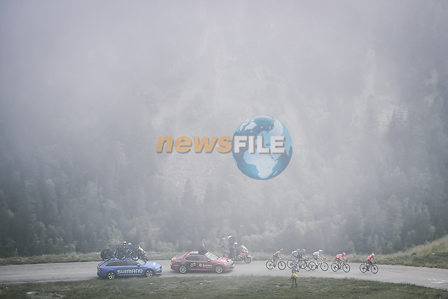 The breakaway shrouded in mist during Stage 17 of the 2021 Tour de France, running 178.4km from Muret to Saint-Lary-Soulan Col du Portet, France. 14th July 2021.  <br /> Picture: A.S.O./Pauline Ballet   Cyclefile<br /> <br /> All photos usage must carry mandatory copyright credit (© Cyclefile   A.S.O./Pauline Ballet)
