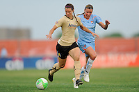 Kiki Bosio (11) of FC Gold Pride is marked by Laura Kalmari (21) of Sky Blue FC. FC Gold Pride defeated Sky Blue FC 1-0 during a Women's Professional Soccer (WPS) match at Yurcak Field in Piscataway, NJ, on May 1, 2010.