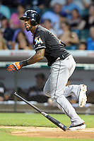 Miami Marlins shortstop Jose Reyes #7 runs to first during a game against the Chicago Cubs at Wrigley Field on July 17, 2012 in Chicago, Illinois. The Marlins defeated the Cubs 9-5. (Tony Farlow/Four Seam Images).