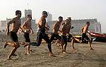 Competitors run to the surf to start the 600-Meter Swim event during action at the First Annual Asbury Park Beach Bar Lifeguard Competition held at the 3rd Avenue beach in Asbury Park.  ASBURY PARK, NJ  8/4/07  8:21:47 PM  PHOTO BY ANDREW MILLS