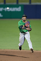 Down East Wood Ducks shortstop Keyber Rodriguez (17) makes a throw to first base against the Kannapolis Cannon Ballers at Atrium Health Ballpark on May 5, 2021 in Kannapolis, North Carolina. (Brian Westerholt/Four Seam Images)