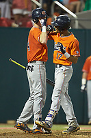 Will Holland (17) of the Auburn Tigers does a fore-arm bash with teammate Steven Williams (41) after hitting  home run against the Army Black Knights at Doak Field at Dail Park on June 2, 2018 in Raleigh, North Carolina. The Tigers defeated the Black Knights 12-1. (Brian Westerholt/Four Seam Images)