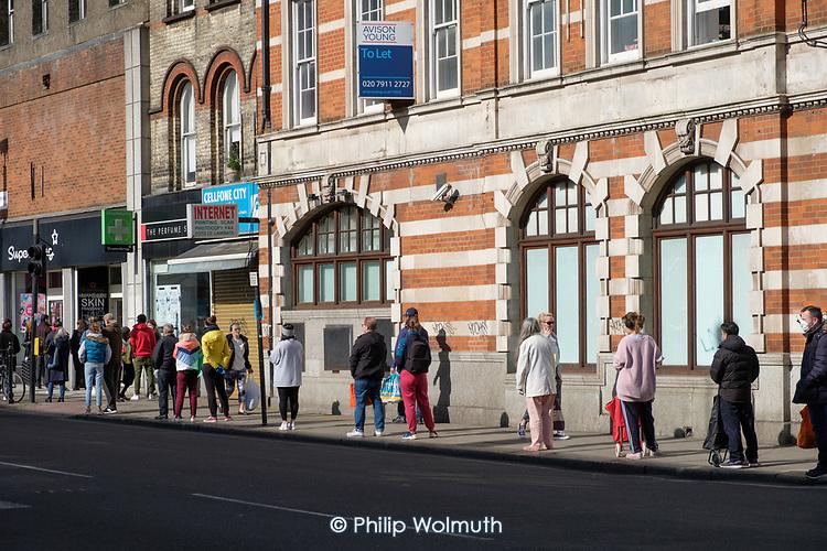 Queue outside a branch of Sainsburys, Kilburn, London, during the Covid-19 pandemic.