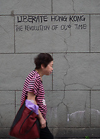 Graffiti is sprayed on the streets in Central, Hong Kong by protestors.  Hong Kong has undergone 9 weeks of protests that began with the introduction of an extradition bill allowing criminals to be deported to the legal system in Mainland China but has grown wider into a pro-democracy movement.