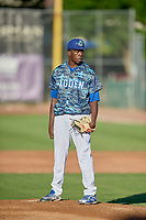 Ogden Raptors starting pitcher Jeronimo Castro (52) looks for the sign against the Rocky Mountain Vibes at Lindquist Field on July 19, 2019 in Ogden, Utah. The Raptors defeated the Vibes 9-5. (Stephen Smith/Four Seam Images)
