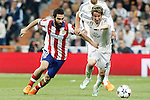 Real Madrid's Fabio Coentrao (r) and Atletico de Madrid's Arda Turan during Champions League 2014/2015 Quarter-finals 2nd leg match.April 22,2015. (ALTERPHOTOS/Acero)
