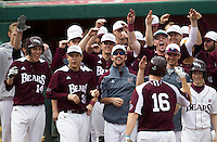 Members of the Missouri State Bears celebrate near home plate after Conor Smith (16) hit a home run during a game against the Northwestern Wildcats at Hammons Field on March 9, 2013 in Springfield, Missouri. (David Welker/Four Seam Images)