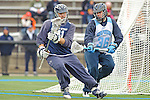 Baltimore- February 4: Nikhon Schuler of Hopkins defends the Hopkins goal during the exhibition between Johns Hopkins and Penn State at Homewood Field on February 04, 2012 in Baltimore, MD.