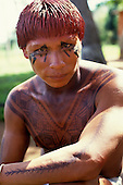 Posto Leonardo, Xingu, Brazil. Man with hair dyed with red Urucum paste and black genipapo body paint.