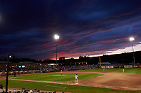 The sun sets behind stormy clouds during a Pioneer League game between the Grand Junction Rockies and Billings Mustangs at Dehler Park on August 15, 2019 in Billings, Montana. Billings defeated Grand Junction 11-2. (Zachary Lucy/Four Seam Images)
