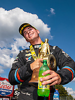 Sep 3, 2018; Clermont, IN, USA; NHRA pro stock driver Tanner Gray celebrates after winning the US Nationals at Lucas Oil Raceway. Mandatory Credit: Mark J. Rebilas-USA TODAY Sports