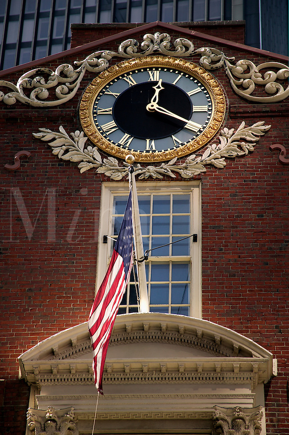 Detail view of USA American flag and ornate clock at the Old State House Boston M