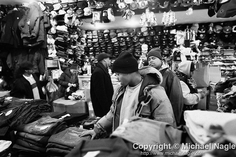 BROOKLYN -- FEBRUARY 14, 2009:  Rapper Aimz shops with his mother Tamika (2L) and friend Joey (R) on Flatbush Avenue on February 14, 2009 in Brooklyn.  (PHOTOGRAPH BY MICHAEL NAGLE)..