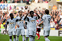 Saturday 19 October 2013 Pictured: Nathan Dyer, Chico Flores and Wilfried Bony celebrate the penalty with Michu of Swansea <br /> Re: Barclays Premier League Swansea City vSunderland at the Liberty Stadium, Swansea, Wales