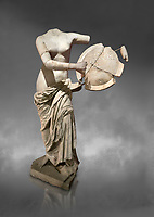 Roman statue of Aphrodite holding a shield. Marble. Perge. 2nd century AD . Antalya Archaeology Museum; Turkey.  Against a grey background