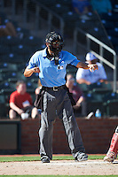 Umpire Gabe Morales makes a call during an Arizona Fall League game between the Glendale Desert Dogs and Surprise Saguaros on October 22, 2016 at Surprise Stadium in Surprise, Arizona.  Surprise defeated Glendale 10-8.  (Mike Janes/Four Seam Images)