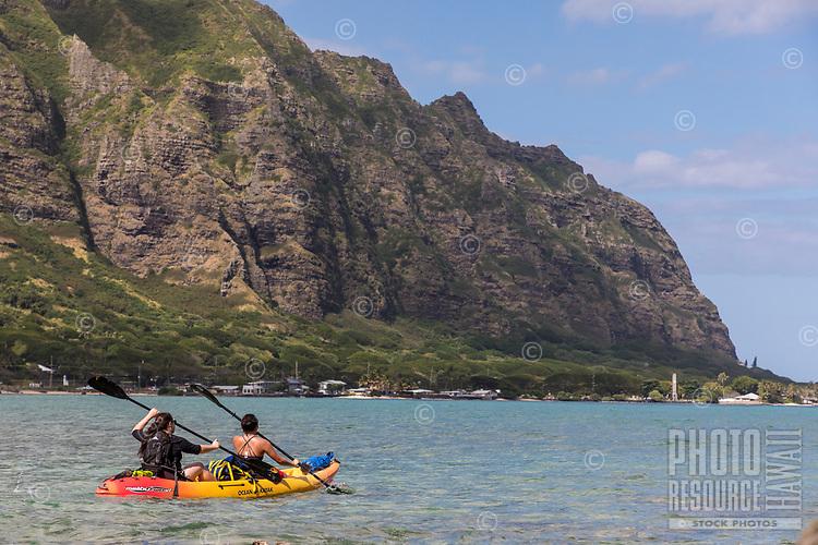 Kayakers at Chinaman's Hat Island, with Kualoa Regional Park in the distance, Windward O'ahu.