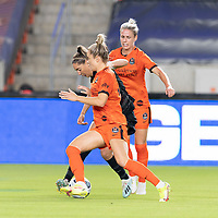 HOUSTON, TX - SEPTEMBER 10: Morgan Gautrat #13 of the Chicago Red Stars attempts to dribble the ball between Sophie Schmidt #13 and Kristie Mewis #19 of the Houston Dash during a game between Chicago Red Stars and Houston Dash at BBVA Stadium on September 10, 2021 in Houston, Texas.