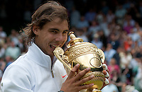 July 04 2010:  Men's Singles Finals. Rafael Nadal is presented with the trophy having beaten Tomas Berdych 6-3 7-5 6-4. Wimbledon international tennis tournament held at the All England Lawn Tennis Club, London, England.