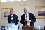 Brian Huggett MBE, the Welsh professional golfer is presented with a new Rolex watch by European Tour chief George O'Grady in the clubhouse of The Royal Porthcawl Golf Club in South Wales ahead of The Senior Open Golf Tournament which begins tomorrow.