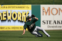 TEMPE, AZ - MARCH 3:  Jack Cust of the Oakland Athletics catches a fly ball in left field during a spring training game against the Los Angeles Angels of Anaheim at Tempe Diablo Stadium in Tempe, Arizona on March 3, 2008. Photo by Brad Mangin