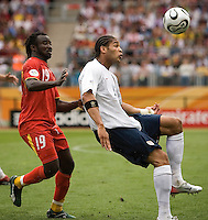 Oguchi Onyewu (22) of the USA plays the ball in front of Razak Pimpong (19) of Ghana. Ghana defeated the USA 2-1 in their FIFA World Cup Group E match at Franken-Stadion, Nuremberg, Germany, June 22, 2006.