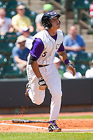 Daniel Wagner #5 of the Winston-Salem Dash runs down the first base line as he watches the flight of the ball against the Wilmington Blue Rocks at BB&T Ballpark on April 24, 2011 in Winston-Salem, North Carolina.   Photo by Brian Westerholt / Four Seam Images