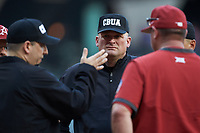 Third base umpire Mark Hutchinson listens to an explanation of a call during the NCAA baseball game between the Arkansas Razorbacks and the Oklahoma Sooners in game two of the 2020 Shriners Hospitals for Children College Classic at Minute Maid Park on February 28, 2020 in Houston, Texas. The Sooners defeated the Razorbacks 6-3. (Brian Westerholt/Four Seam Images)