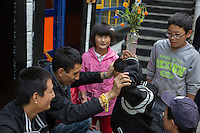 Blind Tibetan headmaster Nyima Wangdu (Left) plays with blind and visually impaired Tibetan students during free time at the School for the Blind in Tibet, in the capital city of Lhasa, September 2016.