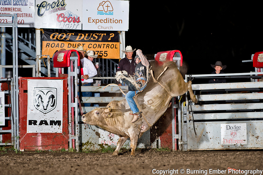 Bayle Worden on Kesler bull Magic Show at the Livingston Roundup 1st perf July 2nd 2019.  Photo by Josh Homer/Burning Ember Photography.  Photo credit must be given on all uses.