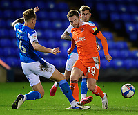 Blackpool's Oliver Turton vies for possession with Peterborough United's Frankie Kent<br /> <br /> Photographer Chris Vaughan/CameraSport<br /> <br /> The EFL Sky Bet League One - Peterborough United v Blackpool - Saturday 21st November 2020 - London Road Stadium - Peterborough<br /> <br /> World Copyright © 2020 CameraSport. All rights reserved. 43 Linden Ave. Countesthorpe. Leicester. England. LE8 5PG - Tel: +44 (0) 116 277 4147 - admin@camerasport.com - www.camerasport.com