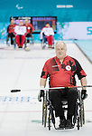 Sochi, RUSSIA - Mar 8 2014 -  Jim Armstrong as Canada takes on Russia in Wheelchair Curling during the 2014 Paralympic Winter Games in Sochi, Russia.  (Photo: Matthew Murnaghan/Canadian Paralympic Committee)