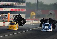 Sept. 3, 2011; Claremont, IN, USA: NHRA funny car driver Jeff Arend (left) alongside Tim Wilkerson during qualifying for the US Nationals at Lucas Oil Raceway. Mandatory Credit: Mark J. Rebilas-