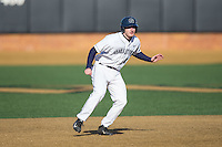 Jake Kuzbel (14) of the Georgetown Hoyas takes his lead off of second base against the Delaware Blue Hens at Wake Forest Baseball Park on February 13, 2015 in Winston-Salem, North Carolina.  The Blue Hens defeated the Hoyas 3-0.  (Brian Westerholt/Four Seam Images)