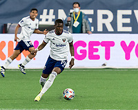 FOXBOROUGH, MA - APRIL 24: Nigel Robertha #19 of D.C. United controls the ball during a game between D.C. United and New England Revolution at Gillette Stadium on April 24, 2021 in Foxborough, Massachusetts.