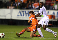 Tom Heinemann #31 Of the Carolina Railhawks gets the ball away from Chris Nurse #8  of the Puerto Rico Islanders during the second leg of the USSF-D2 championship match at WakeMed Soccer Park, in Cary, North Carolina on October 30 2010.
