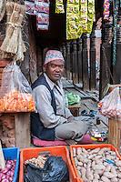 Bhaktapur, Nepal.  Vegetable Vendor Wearing Traditional Hat (Topi).