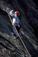 Rock Climber / Rockclimber rock climbing / rockclimbing at Skaha Bluffs, near Pentiction, BC, Okanagan Valley, British Columbia, Canada - Safety Helmet Protection