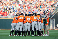 Oklahoma State Cowboys pregame huddle before their game against the Arizona Wildcats in the NCAA College World Series on June 20, 2016 at TD Ameritrade Park in Omaha, Nebraska. Oklahoma State defeated Arizona 1-0. (Andrew Woolley/Four Seam Images)