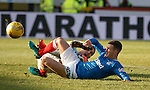 Thistle keeper Thorsten Stuckmann saves from Jason Holt