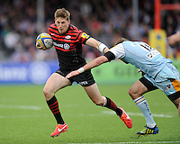 20130512 Copyright onEdition 2013©.Free for editorial use image, please credit: onEdition..David Strettle of Saracens hands off Stephen Myler of Northampton Saints during the Premiership Rugby semi final match between Saracens and Northampton Saints at Allianz Park on Sunday 12th May 2013 (Photo by Rob Munro)..For press contacts contact: Sam Feasey at brandRapport on M: +44 (0)7717 757114 E: SFeasey@brand-rapport.com..If you require a higher resolution image or you have any other onEdition photographic enquiries, please contact onEdition on 0845 900 2 900 or email info@onEdition.com.This image is copyright onEdition 2013©..This image has been supplied by onEdition and must be credited onEdition. The author is asserting his full Moral rights in relation to the publication of this image. Rights for onward transmission of any image or file is not granted or implied. Changing or deleting Copyright information is illegal as specified in the Copyright, Design and Patents Act 1988. If you are in any way unsure of your right to publish this image please contact onEdition on 0845 900 2 900 or email info@onEdition.com