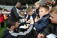 Wednesday, 23 April 2014<br /> Pictured: Alvaro Vazquez and Leroy Lita signing autographs for supporters.<br /> Re: Swansea City FC are holding an open training session for their supporters at the Liberty Stadium, south Wales,