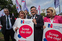 Nurses at a rally organised by the Royal College of Nursing Trade Union in Parliament square. They were demanding that the government scrap the pay cap on public sector workers. 6-9-11