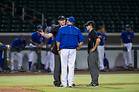 Minor League Baseball umpires Ray Patchen and John Perez explain a batter interference call to AZL Cubs manager Carmelo Martinez during a game between the AZL Cubs and AZL Giants on September 6, 2017 at Sloan Park in Mesa, Arizona. AZL Giants defeated the AZL Cubs 6-5 to even up the Arizona League Championship Series at one game a piece. (Zachary Lucy/Four Seam Images)