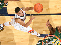 Dec. 20, 2010; Charlottesville, VA, USA; Virginia Cavaliers guard Mustapha Farrakhan (2) shoots the ball in front of Norfolk State Spartans forward Kyle O'Quinn (10) during the game at the John Paul Jones Arena. Virginia won 50-49. Mandatory Credit: Andrew Shurtleff