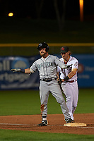 Peoria Javelinas right fielder Eric Filia (4), of the Seattle Mariners organization, rules himself safe after beating the tag of Taylor Sparks (6) before umpire Ramon De Jesus (not shown) delivers the call during an Arizona Fall League game against the Scottsdale Scorpions on October 20, 2017 at Scottsdale Stadium in Scottsdale, Arizona. the Javelinas defeated the Scorpions 2-0. (Zachary Lucy/Four Seam Images)