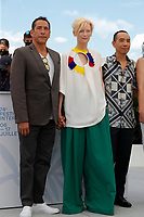 """CANNES, FRANCE - JULY 16: Elkin Diaz, Tilda Swinton, Director Apichatpong Weerasethakul at photocall for the film """"Memoria"""" at the 74th annual Cannes Film Festival in Cannes, France on July 16, 2021  <br /> CAP/GOL<br /> ©GOL/Capital Pictures"""